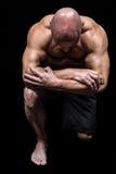 Bodybuilder kneeling down Royalty Free Stock Photos