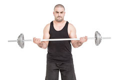Bodybuilder lifting heavy barbell weights Royalty Free Stock Image