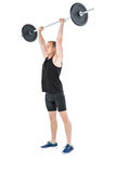 Bodybuilder lifting heavy barbell weights Royalty Free Stock Photo