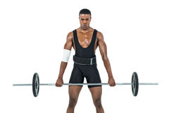 Bodybuilder lifting heavy barbell weights Royalty Free Stock Photos