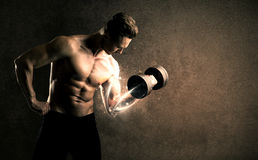 Bodybuilder lifting weight with energetic white lines concept Stock Photography