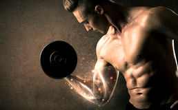 Bodybuilder lifting weight with energetic white lines concept Royalty Free Stock Photography