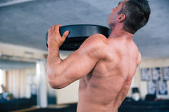 Bodybuilder lifting weight Stock Image