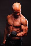 Bodybuilder lifting weight Stock Photo
