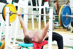 Bodybuilder lifting weight at sport gym Royalty Free Stock Photography