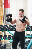 Bodybuilder lifting weight at sport gym Royalty Free Stock Photos