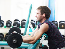 Bodybuilder lifting weight at sport gym Royalty Free Stock Images