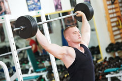 Bodybuilder lifting weight at sport gym Stock Photos