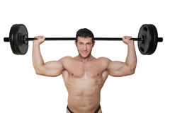 Bodybuilder lifting weights. Stock Photo