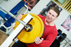 Bodybuilder loading weight at sport gym Royalty Free Stock Image