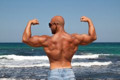 Bodybuilder man with bare chest in jeans stock photos