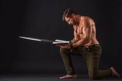 Bodybuilder man bowing Stock Photos
