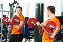 Bodybuilder man doing biceps muscle exercises Stock Photos