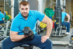 Bodybuilder man doing biceps muscle exercises Stock Image