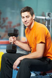 Bodybuilder man doing biceps muscle exercises Stock Images