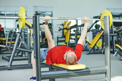 Bodybuilder man doing muscle exercises with weight Royalty Free Stock Image