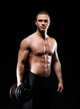 Bodybuilder man with a dumbbell Royalty Free Stock Photos