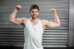 Bodybuilder man flexing his muscles Royalty Free Stock Photo