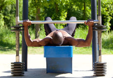 Bodybuilder man lifting weights Stock Images