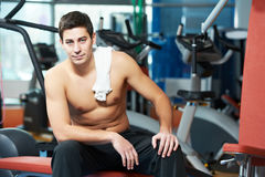 Bodybuilder man after muscle exercises in gym Stock Images