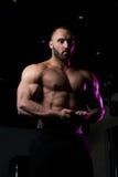 Bodybuilder Man Posing In The Gym Royalty Free Stock Image