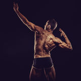 Bodybuilder man posing, showing perfect abs, houlders, biceps, triceps, chest Royalty Free Stock Photo