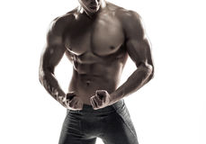 Bodybuilder man posing, showing perfect abs, houlders, biceps, triceps, chest Stock Image