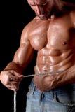 Bodybuilder man with tape measure Stock Photos