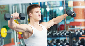 Bodybuilder man training with dumbbells Stock Photos