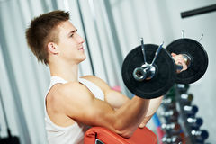 Bodybuilder man workout biceps muscle exercises Royalty Free Stock Photography