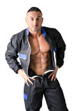 Bodybuilder mechanic opening coverall to show muscular body Stock Photography