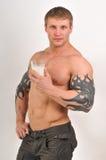 Bodybuilder with milk Stock Photo