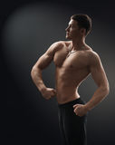 Bodybuilder muscle side shows Royalty Free Stock Photo