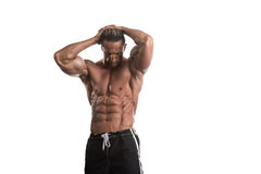 Bodybuilder musculaire Guy Posing Over White Background Images stock