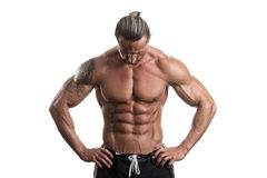 Bodybuilder musculaire Guy Posing Over White Background Photo libre de droits