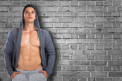 Bodybuilder muscular young man hoodie copyspace looking up think Stock Photography