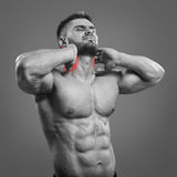 Bodybuilder neck pain Royalty Free Stock Images