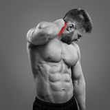 Bodybuilder neck pain Stock Photo