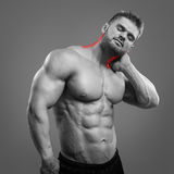 Bodybuilder Neck pain Royalty Free Stock Photos