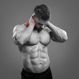 Bodybuilder neck pain Stock Photography