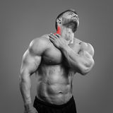 Bodybuilder neck pain Stock Photos