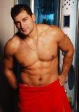 Bodybuilder nell'acquazzone Fotografie Stock
