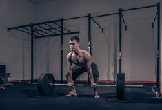 Bodybuilder, one young man, barbell deadlift Royalty Free Stock Images