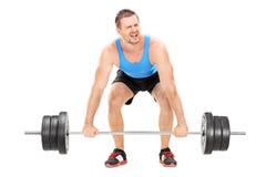 Bodybuilder ono zmaga się podnosić barbell Obrazy Stock