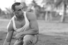 Bodybuilder in the park Royalty Free Stock Image