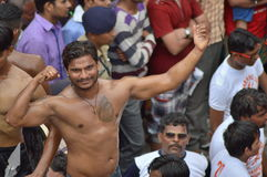 Bodybuilder performance on street. Bodybuilder from local akhada is performing on street during Rathyatra festival, Ahmedabad. Akhada is a place of practice of Stock Photo