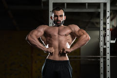 Bodybuilder Performing Front Lat Spread Pose Royalty Free Stock Photos