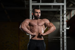 Bodybuilder Performing Front Lat Spread Pose Royalty Free Stock Image