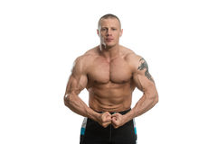 Bodybuilder Performing Most Muscular Pose Over White Background Royalty Free Stock Photos