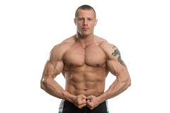 Bodybuilder Performing Most Muscular Pose Over White Background Stock Photography